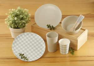 Some of Coles' new reusable and single-use tableware range.